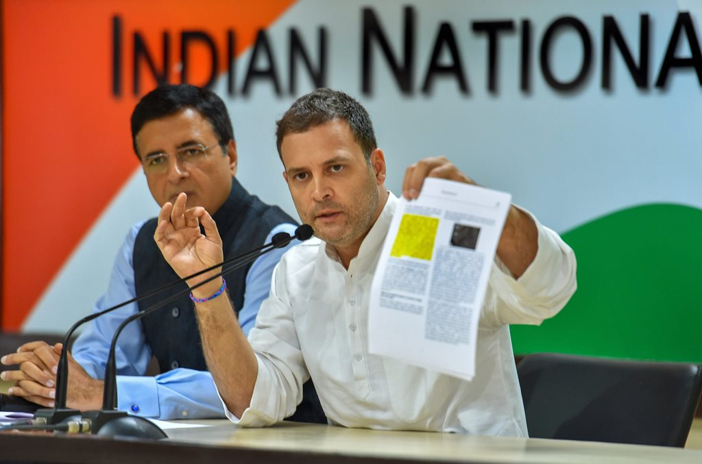 New Delhi: Congress President Rahul Gandhi speaks as AICC chief spokesperson Randeep Singh Surjewala looks on, during a press conference at AICC HQ, in New Delhi, Thursday, Oct 11, 2018. (PTI Photo/Subhav Shukla) (PTI10_11_2018_000032B)