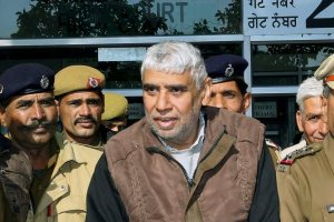 **FILE** Chandigarh: In this file photo dated Dec 23, 2014, is seen self-proclaimed godman Rampal being produced in Punjab & Haryana High Court in Chandigarh. Rampal and 27 of his followers on Thursday, Oct 11, 2018, were charged with murder and wrongful confinement after four women and a child were found dead in his Satlok Ashram in Barwala town in Hisar on November 19, 2014. (PTI Photo) (PTI10_11_2018_000067B)