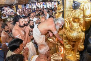 Sabarimala: Melsanthi Unnikrishnan Nampoothiri opens the Sabarimala temple for the five-day monthly pooja in the Malayalam month of 'Thulam', Sabarimala, Wednesday, Oct. 17, 2018. Tension was witnessed outside Sabarimala temple that was opened for the first time for women between the age of 10 and 50 on Wednesday following the Supreme Court verdict, turning over the age-old custom of not admitting them. (PTI Photo) (PTI10_17_2018_000155B)