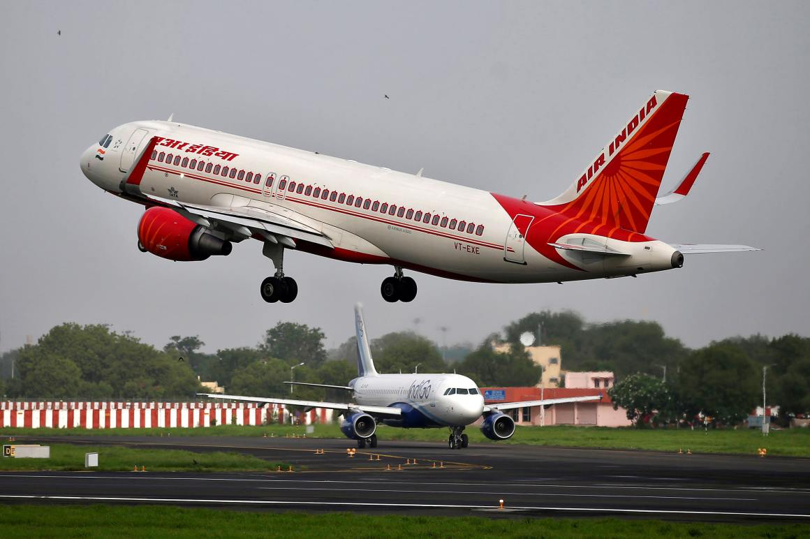 An Air India aircraft takes off as an IndiGo Airlines aircraft waits for clearance at the Sardar Vallabhbhai Patel International Airport in Ahmedabad, India, on July 7, 2017 © Reuters