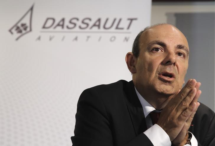Eric Trappier, Dassault Aviation Chairman and Chief Executive Officer, speaks during the company's 2014 First-Half results presentation in Saint Cloud near Paris July 25, 2014. REUTERS/Philippe Wojazer/Files