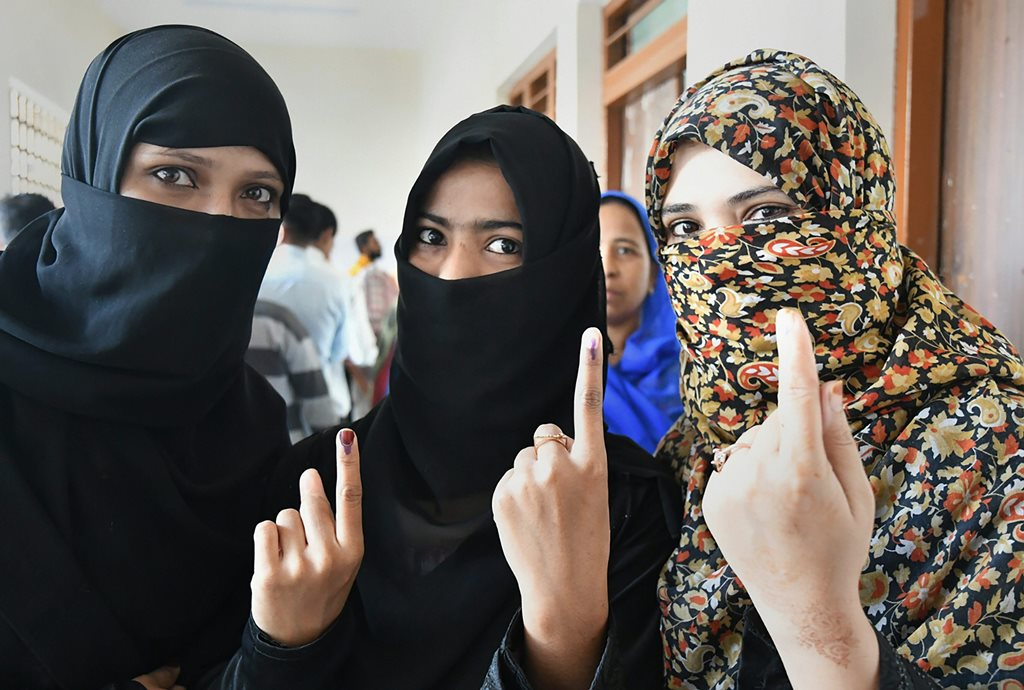 Bhopal: Muslim women show their fingers marked with indelible ink after casting votes for the Assembly elections, outside a polling station in Bhopal, Madhya Pradesh, Wednesday, Nov 28, 2018. (PTI Photo)   (PTI11_28_2018_000048)