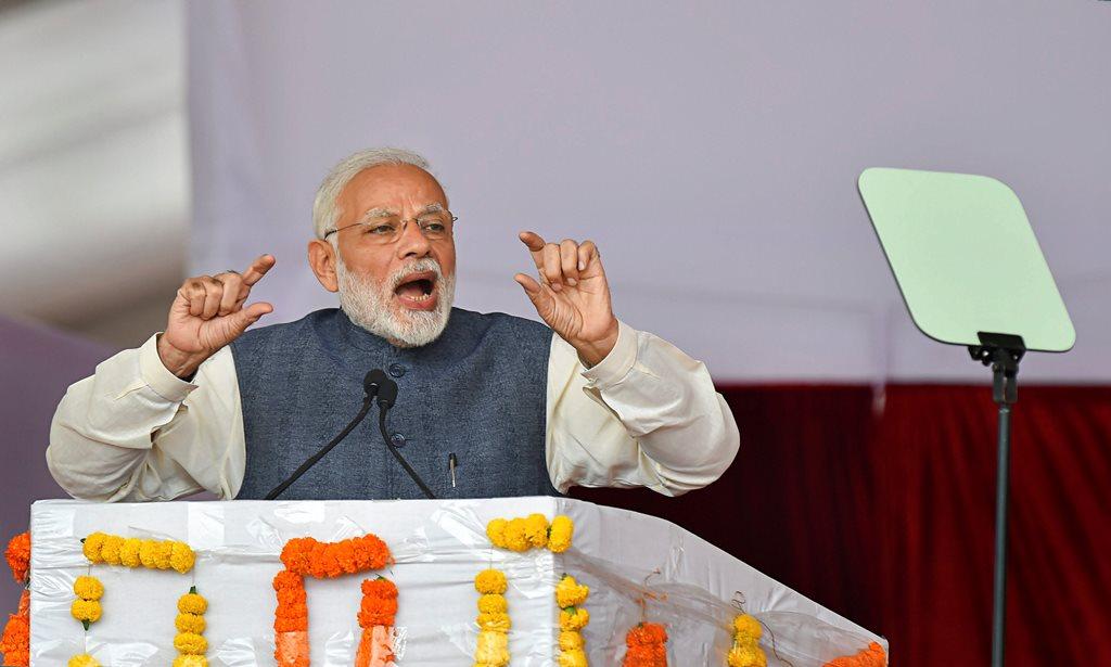 Gurugram: Prime Minister Narendra Modi gestures as he addresses a public meeting during 'Jan Vikas' rally, at Sultanpur village, in Gurugram, Monday, Nov.19, 2018. (PTI Photo/Kamal Kishore)(PTI11_19_2018_000091B)