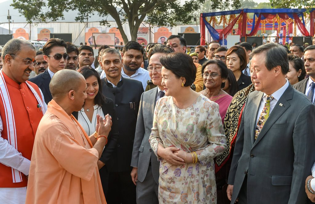 Ayodhya: Uttar Pradesh Chief Minister Yogi Adityanath and South Korean first lady Kim Jung-sook on their arrival at the Queen Huh Park in Ayodhya, Tuesday. Nov 6, 2018. (PTI Photo/Nand Kumar) (PTI11_6_2018_000097B)