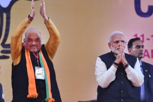New Delhi: Prime Minister Narendra Modi with BJP National President Amit Shah on the second day of the two-day BJP National Convention, at Ramlila Ground in New Delhi, Saturday, Jan 12, 2019. (PTI Photo/Kamal Kishore) (PTI1_12_2019_000174B)