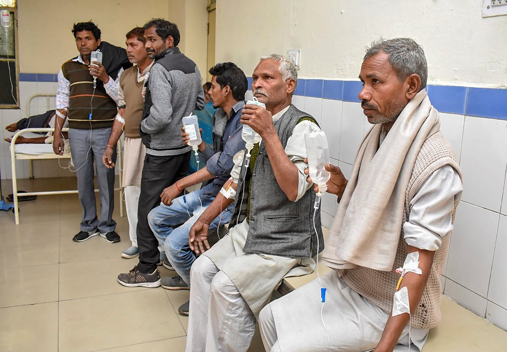 Haridwar: Victims undergo treatment on being poisoned after consuming a spurious liquor, at a hospital in Haridwar, Saturday, Feb 9, 2019. Thirty-four people died in two adjoining districts allegedly after drinking spurious liquor at a village in Uttarakhand's Haridwar. (PTI Photo) (PTI2_9_2019_000103B)