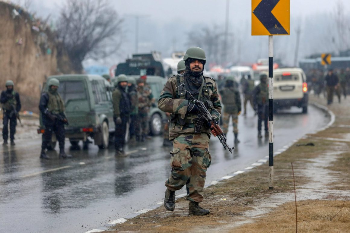 Awantipora: Army soldiers near the site of suicide bomb attack at Lathepora Awantipora in Pulwama district of south Kashmir, Thursday, February 14, 2019. At least 30 CRPF jawans were killed and dozens other injured when a CRPF convoy was attacked. (PTI Photo/S Irfan) (PTI2_14_2019_000179B)