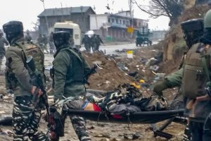 *BEST QUALITY AVAILABLE* Awantipora: Jawans carry a victim after militants attacked a CRPF convoy in Goripora area of Awantipora town in Pulwama district, Thursday, Feb 14, 2019. At least 18 CRPF jawans were reportedly killed in the attack. (PTI Photo) (PTI2_14_2019_000126B)