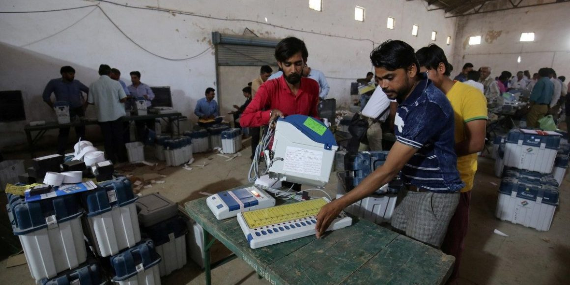 Election staff check Voter Verifiable Paper Audit Trail (VVPAT) machines and Electronic Voting Machines (EVM) ahead of India's general election at a warehouse in Ahmedabad, India, March 6, 2019. Credit: Reuters/Amit Dave/File Photo