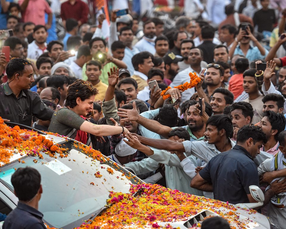 Ayodhya: Congress General Secretary and Uttar Pradesh - East incharge Priyanka Gandhi Vadra greets her supporters during a roadshow on the last day of her 3-day campaign ahead of Lok Sabha elections, in Ayodhya, Friday, March 29, 2019. (PTI Photo/Nand Kumar) (PTI3_29_2019_000138B)