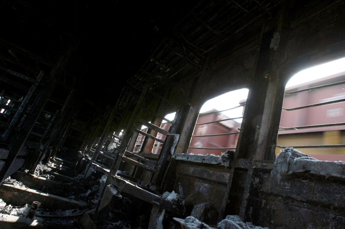 FILE PHOTO: A view of a burnt carriage of Samjhauta Express train in Deewana, near Panipat town, February 19, 2007. REUTERS/Desmond Boylan/File Photo