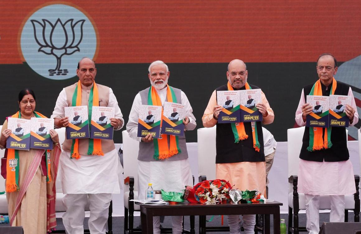 Indian Prime Minister Narendra Modi (C), chief of India's ruling Bharatiya Janata Party (BJP) Amit Shah (2-R), India's Home Minister Rajnath Singh (2-L) India's Foreign Minister Sushma Swaraj (L) and India's Finance Minister Arun Jaitley display copies of their party's election manifesto for the April/May general election, in New Delhi, India, April 8, 2019. REUTERS/Adnan Abidi