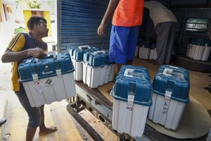 Chennai: Workers carry boxes containing Electronic Voting Machines (EVM) and Voter Verified Paper Audit Trail machines (VVPATs) at a distribution centre, ahead of the second phase of the 2019 Lok Sabha elections, at Nandhanam Arts College in Chennai, Wednesday, April 17, 2019. (PTI Photo/R Senthil Kumar)(PTI4_17_2019_000108B)