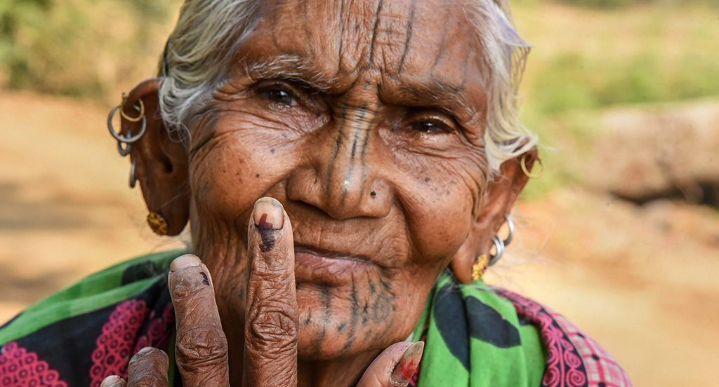Kandhamaal: An elderly voter show her finger marked with indelible ink at Adabadi polling booth during the second phase of Lok Sabha elections in Kandhamaal, Thursday, April 18, 2019. PTI Photos