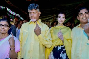 Amaravati: TDP President and Andhra Pradesh Chief Minister N Chandrababu Naidu and his family members show their finger marked with indelible ink after casting vote during the first phase of the general elections, in Amaravati, Thursday, April 11, 2019. (PTI Photo)(PTI4_11_2019_000133B)