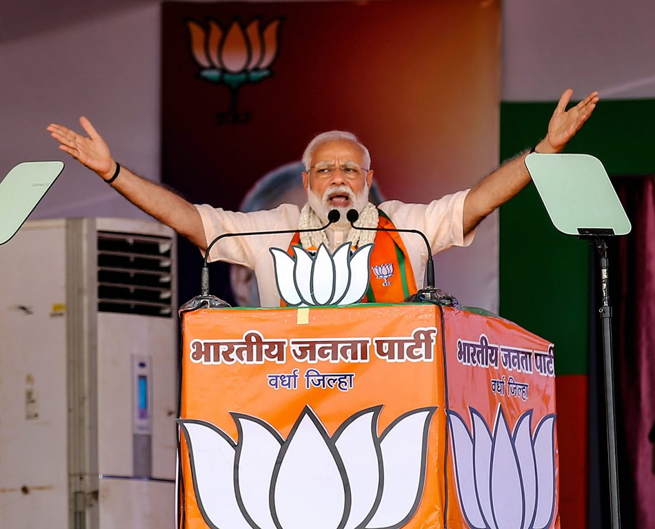 Wardha: Prime Minister Narendra Modi gestures as he speaks during an election rally, ahead of the Lok Sabha polls, in Wardha, Monday, April 01, 2019. (PTI Photo)(PTI4_1_2019_000071B)