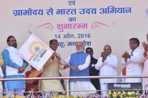 "The Prime Minister, Shri Narendra Modi launching the ""Gram Uday se Bharat Uday"" Abhiyan, in Mhow, Madhya Pradesh on April 14, 2016.  The Union Minister for Social Justice and Empowerment, Shri Thaawar Chand Gehlot, the Chief Minister of Madhya Pradesh, Shri Shivraj Singh Chouhan and other dignitaries are also seen."
