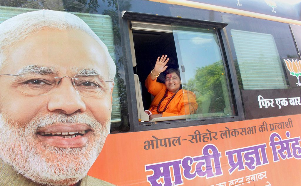 Bhopal: BJP candidate Sadhvi Pragya Singh Thakur waves at supporters during her election campaign for Lok Sabha polls, at Sewaniya Gond in Bhopal, Monday, May 6, 2019. (PTI Photo) (PTI5_6_2019_000131B)
