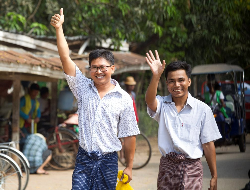Yangon: Reuters journalists Wa Lone, left, and Kyaw She Oo wave as they walk out from Insein Prison after being released in Yangon, Myanmar Tuesday, May 7, 2019. The chief of the prison said two Reuters journalists who were imprisoned for breaking the country's Officials Secrets Act have been released. AP/PTI(AP5_7_2019_000022B)
