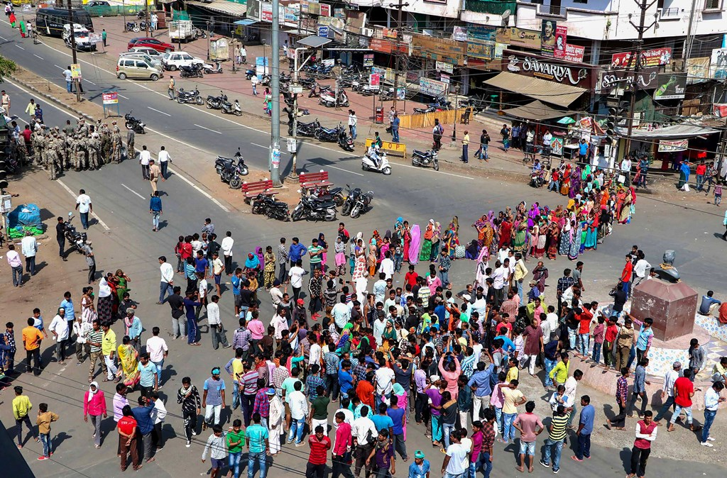 Bhopal: Local residents stage a 'chakka jam' protest demanding capital punishment for the accused in the rape and killing of a minor girl, at Nehru Nagar Square in Bhopal, Monday, June 10, 2019. (PTI Photo) (PTI6_10_2019_000079B)