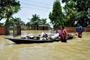 Kamrup: People shift belongings from their submerged house at a flood-affected area, at Hatishila in Kamrup, Tuesday, July 16, 2019. (PTI Photo) (PTI7_16_2019_000096B)