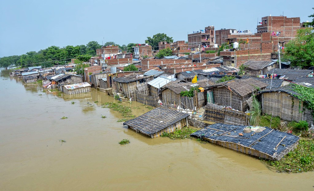 Muzaffarpur: A flooded village following incessant monsoon rains, at Mushari in Muzaffarpur district, Monday, July 15, 2019. (PTI Photo) (PTI7_15_2019_000166B)