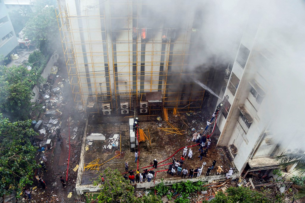Mumbai: Fire fighters douse a fire that broke out at MTNL office building at Bandra, in Mumbai, Monday, July 22, 2019. (PTI Photo) (PTI7_22_2019_000149B)