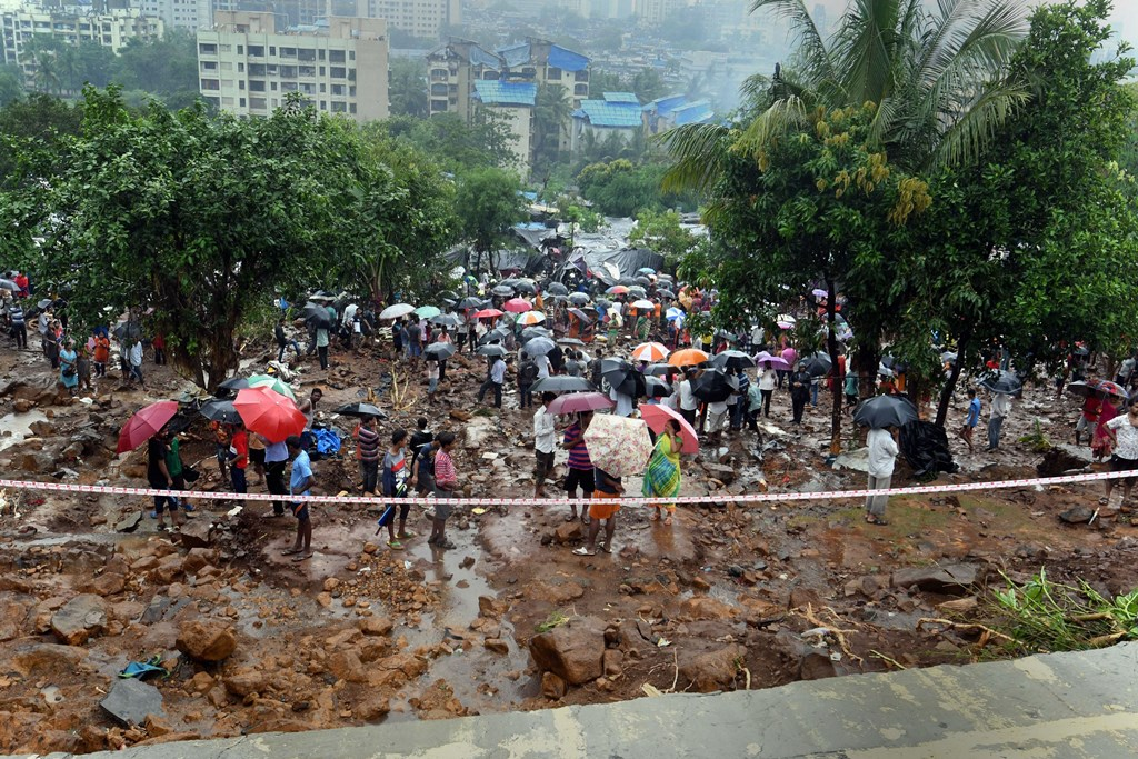 **EDS: RPT WITH ADDED INFO** Malad: Rescue operations in progress at the site where a portion of a compound wall collapsed and many shanties were washed away due to incessant rain, in Pimpripada of Malad East, Mumbai, Tuesday, July 02, 2019. (PTI Photo/Shirish Shete)(PTI7_2_2019_000084B)