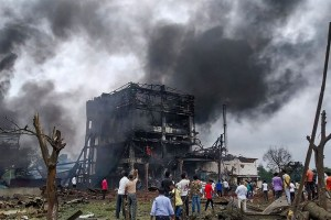 Dhule: Smoke rises from the charred remains of chemical factory after cylinder explosion in Dhule Maharashtra, Saturday, Aug 31, 2019. PTI Photos.