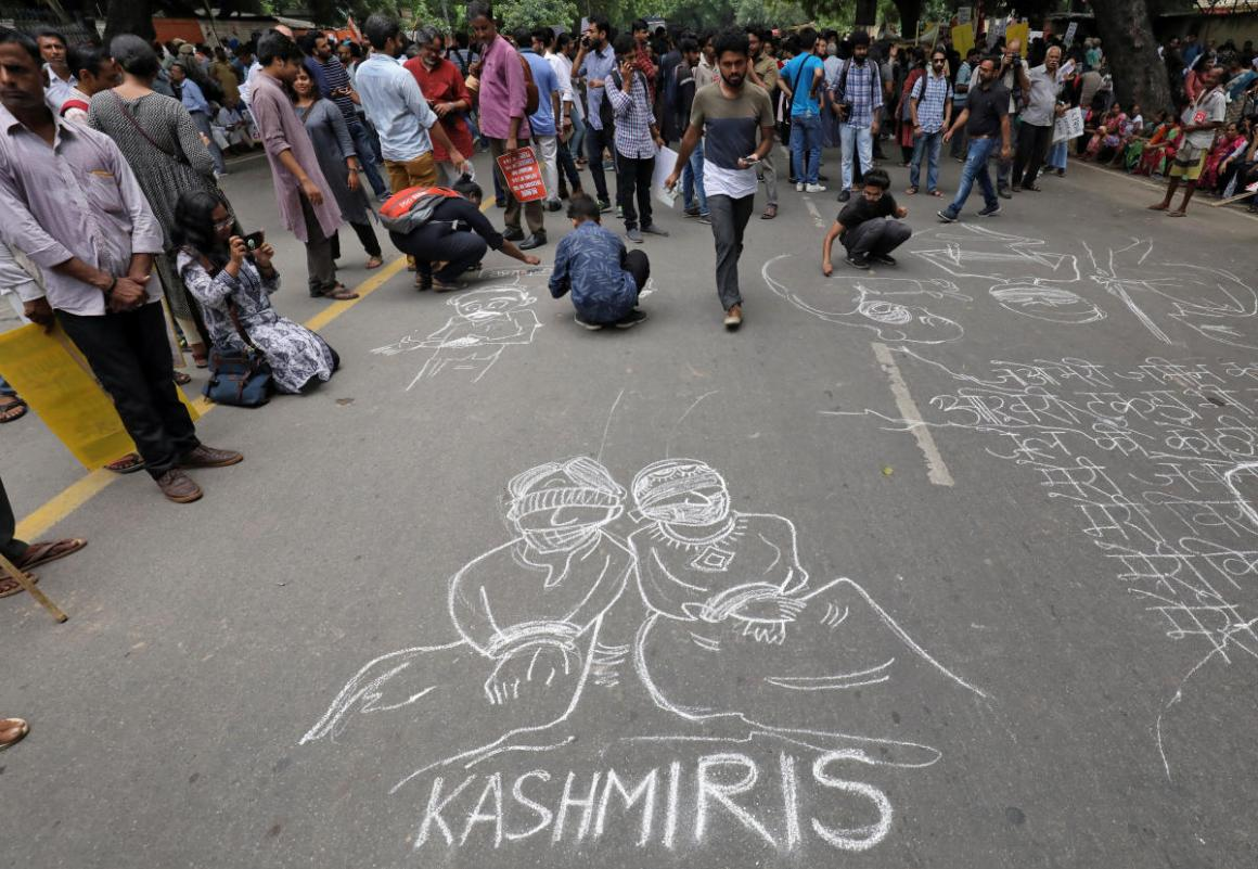 People draw and write messages on a road during a protest against the scrapping of the special constitutional status for Kashmir by the government, in New Delhi, India, August 7, 2019. REUTERS/Anushree Fadnavis