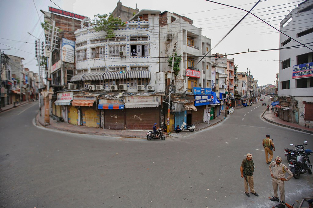 Jammu: Security personnel guard in the Raghunath Bazar during restrictions in Jammu, Tuesday, Aug 6, 2019. Restrictions and night curfews were imposed in several districts of Jammu and Kashmir in the view of the revocation of Article 370 and introduction J & K Reorganisation Bill in Parliament. (PTI Photo) (PTI8_6_2019_000053B)