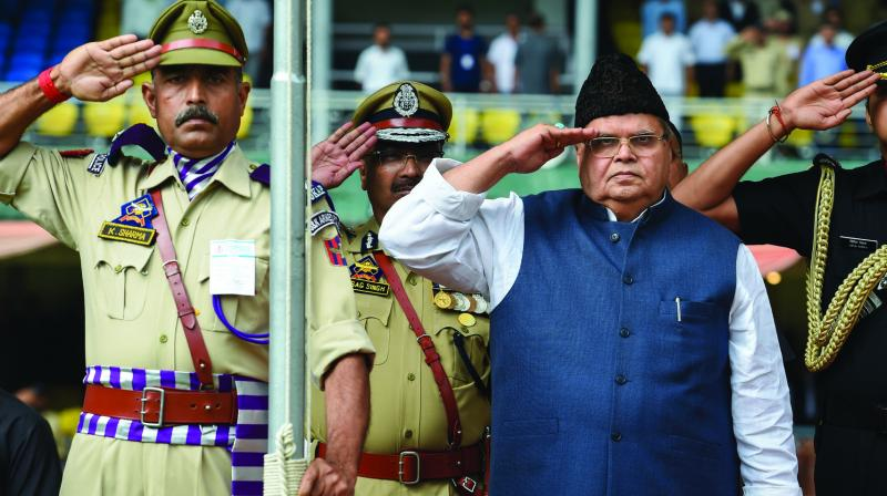 Jammu and Kashmir governor Satya Pal Malik salutes as he hoists the tricolour to mark Independence Day in Srinagar on Thursday. (Photo: PTI)