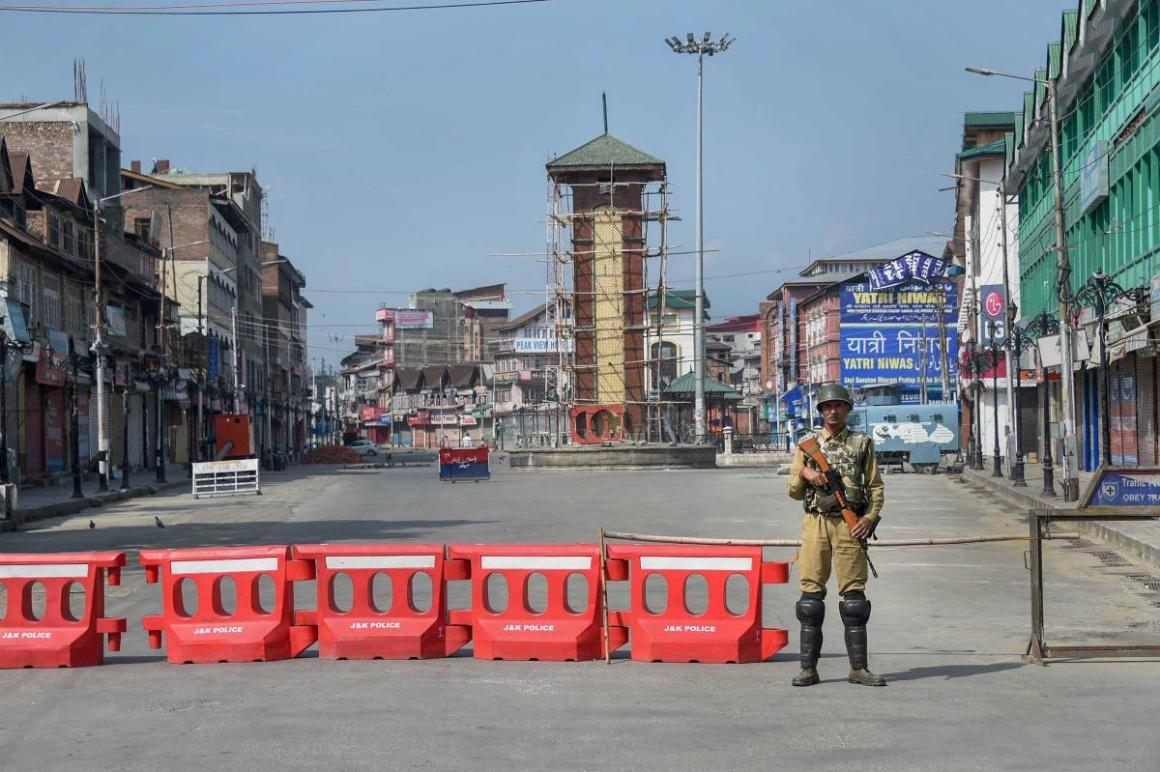 Security personnel stands guard during restrictions, in Srinagar. PTI