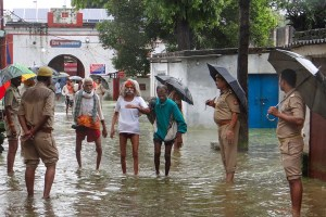 Ballia: Police officials relocate prisoners from the flooded premises of district jail, located near River Ganga, in Ballia, Monday, Sept. 30, 2019. (PTI Photo) (PTI9_30_2019_000156B)