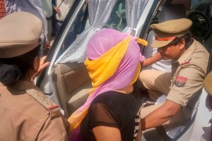 Shahjahanpur: The woman law student (face covered), who alleged BJP leader Chinmayanand of sexual misconduct and harassment, arrested by the Special Investigation Team (SIT) a day after she was detained for questioning in an extortion case, in Shahjahanpur, Wednesday, Sept. 25, 2019. (PTI Photo) (PTI9_25_2019_000051B)