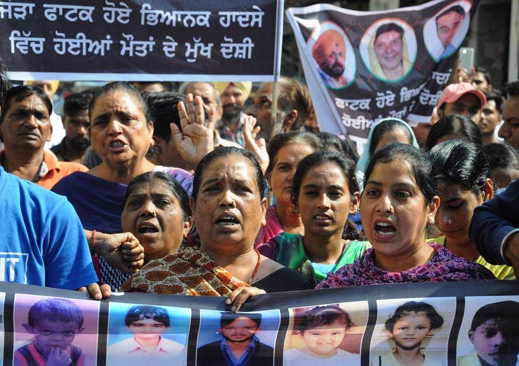 Amritsar: Family members of victims, who died in the train tragedy on Dussehra last year, protest against the state government demanding justice and claiming the promised jobs atJoda Phatak,in Amritsar, Tuesday, Oct. 8, 2019. At least 61 people were killed and over 70 sustained injuries in the tragic incident near Joda Phatak in Amritsar on October 19 last year. (PTI Photo) (PTI10_8_2019_000096B)