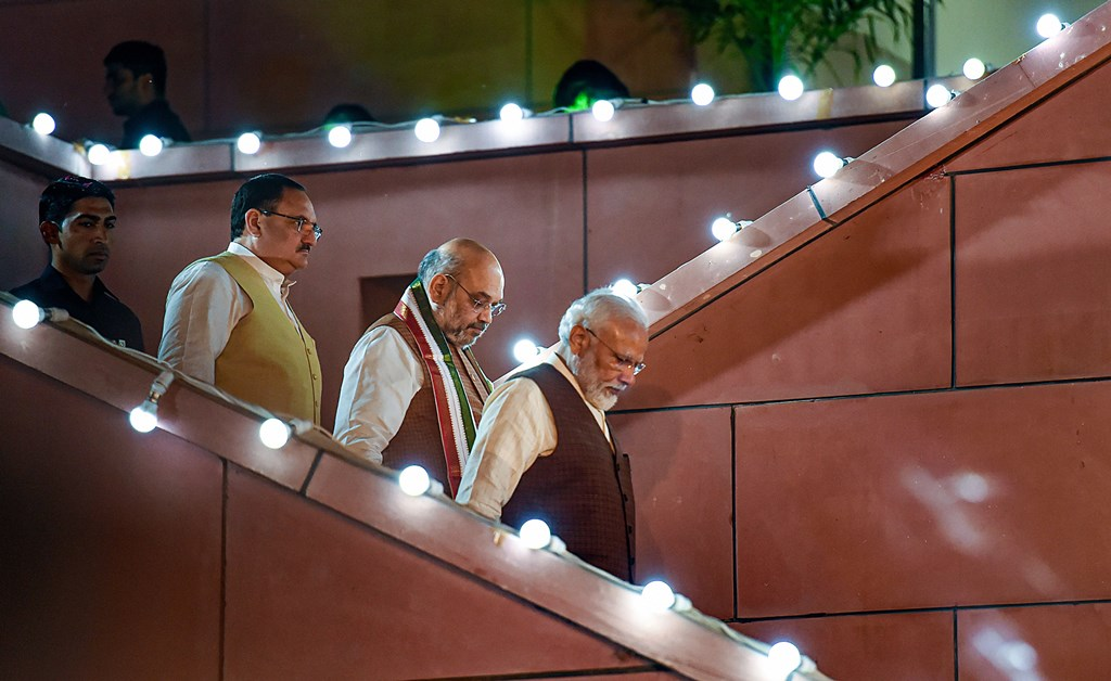 New Delhi: Prime Minister Narendra Modi arrives to address his supporters after the party's victory in both Haryana and Maharashtra Assembly polls, at BJP HQ, in New Delhi, Thursday, Oct 24, 2019. BJP President Amit Shah and BJP Working President JP Nadda are also seen (PTI Photo/Atul Yadav)(PTI10_24_2019_000306B)