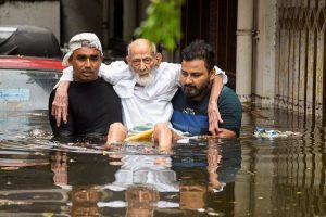 Patna: An elderly person being rescued from a flood-affected colony at Rajendra Nagar in Patna, Monday, Sept. 30, 2019. (PTI Photo)   (PTI9_30_2019_000086B)