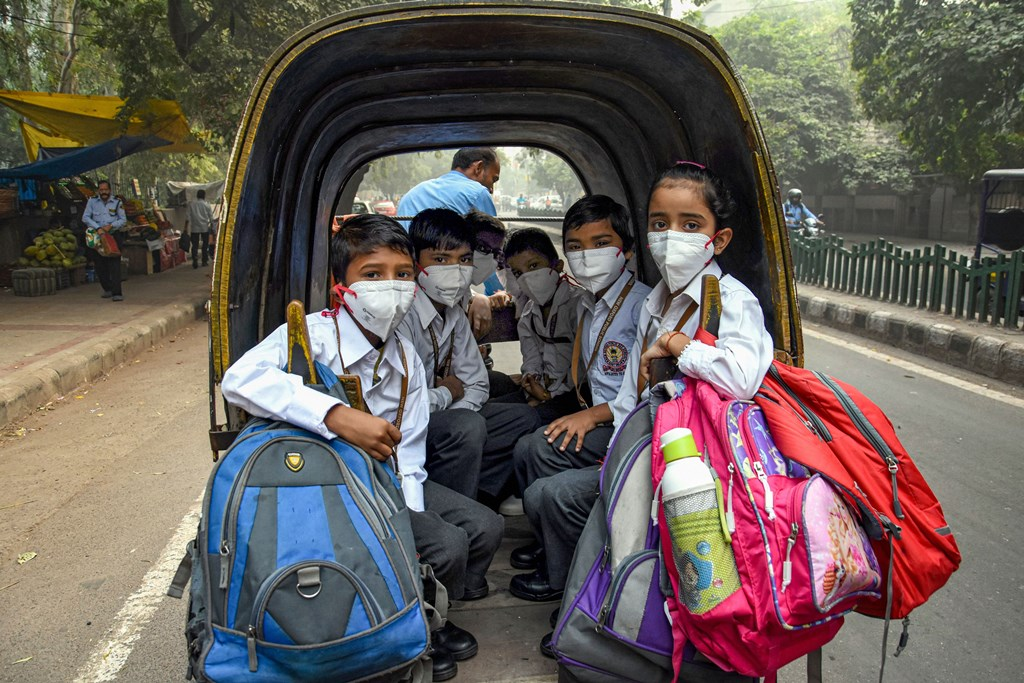 New Delhi: Students, wearing masks to get protection from air-pollution, go to their school by a rickshaw, in New Delhi, Friday, Nov. 1, 2019. (PTI Photo) (PTI11_1_2019_000066B)