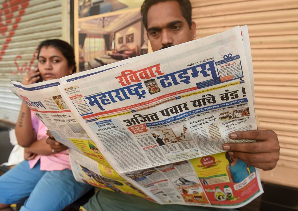 Mumbai: A local reads newspaper fronted with headlines on Maharashtra government formation, in Mumbai, Sunday, Nov. 24, 2019. (PTI Photo/Mitesh Bhuvad)(PTI11_24_2019_000036B)