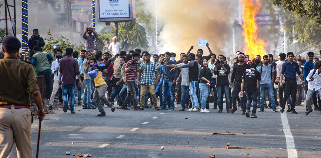 Guwahati: Protesters clash with the police during their march against the Citizenship (Amendment) Bill, 2019, in Guwahati, Wednesday, Dec. 11, 2019. (PTI Photo) (PTI12_11_2019_000153B)