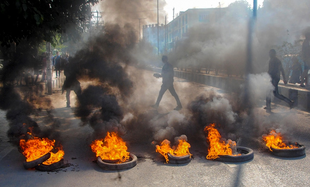 Guwahati: Demonstrators burn tyres during a strike called by All Assam Students' Union (AASU) and the North East Students' Organisation (NESO) in protest against the Citizenship Amendment Bill, in Guwahati, Tuesday, Dec. 10, 2019. (PTI Photo)(PTI12_10_2019_000105B)
