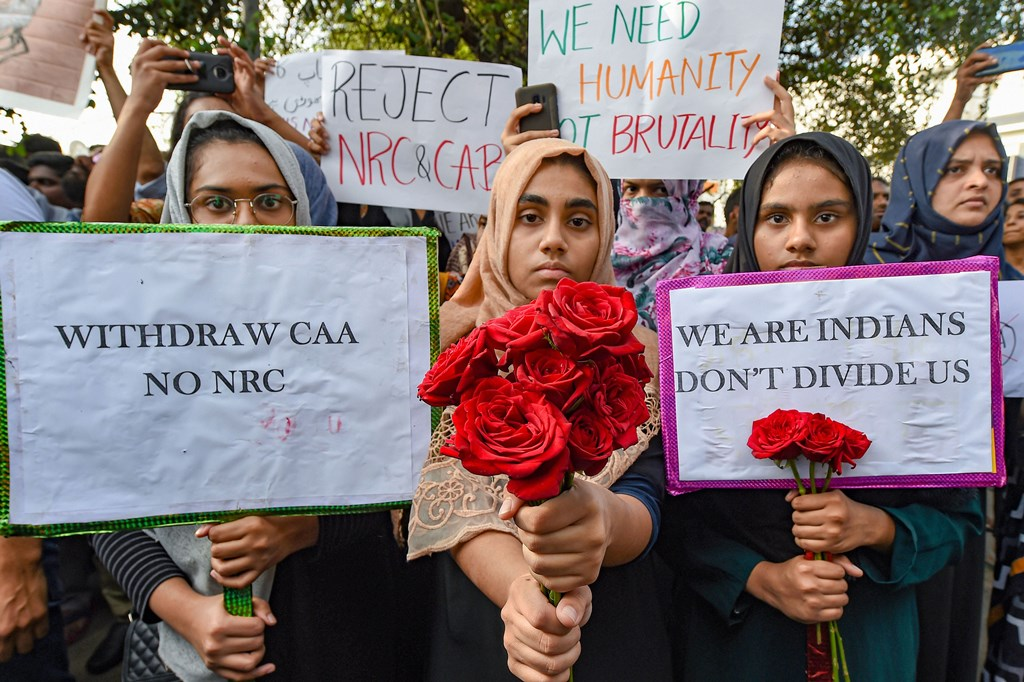 Chennai: Protestors hold placards and roses during a demonstration against the Citizenship Amendment Act (CAA), in Chennai, Thursday, Dec. 19, 2019. (PTI Photo)(PTI12_19_2019_000302B)