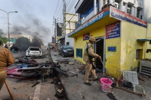 Lucknow: A policeman at Madeyganj police outpost where five motorcycles were set ablaze, in Lucknow, Thursday, Dec. 19, 2019. (PTI Photo/Nand Kumar) (PTI12_19_2019_000165B)