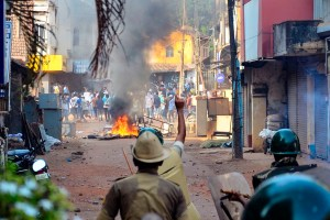 Mangaluru: Police personnel pelt stones during their clash with the protestors participating in a rally against the amended Citizenship Act and NRC, in Mangaluru, Thursday, Dec. 19, 2019. (PTI Photo) (PTI12_19_2019_000256B)