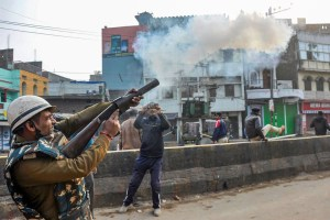 Patna: Police personnel fire tear gas shells at protesters during a rally against NRC and amended Citizenship Act that turned violent, at Phulwarisharif, in Patna,Saturday,Dec 21,2019.( PTI Photo)(PTI12_21_2019_000242B)