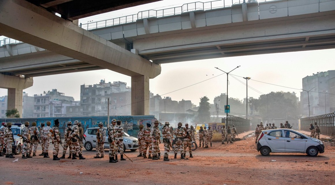 New Delhi: Security personnel patrol streets following clashes over the new citizenship law, near Maujpur metro station in northeast Delhi, Wednesday, Feb. 26, 2020. Communal violence over the amended citizenship law in northeast Delhi had claimed at least 20 lives till today. (PTI Photo)(PTI2_26_2020_000062B)