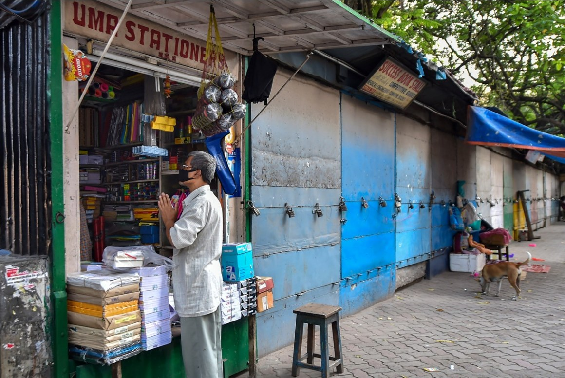 Kolkata: A book seller offers prayers while closing his shop for next few days before lockdown in the wake of coronavirus pandemic, at a book market in Kolkata, Monday, March 23, 2020. (PTI Photo/Swapan Mahapatra)(PTI23-03-2020 000157B)