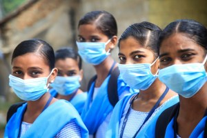 Kanyakumari: Students wearing maks in the wake of coronavirus pandemic pose for a photograph at Nagercoil in Kanyakumari district, Thursday, March 19, 2020. (PTI Photo)(PTI19-03-2020_000250B)