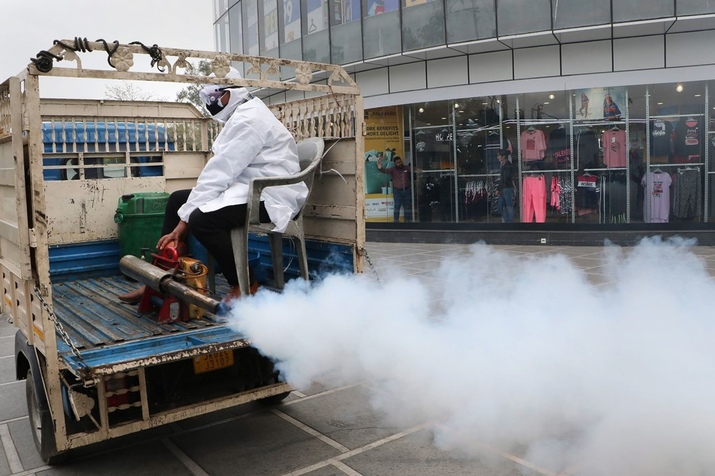 Jammu: A Jammu Municipal Corporation (JMC) staff member fumigates to disinfect a street in the wake of the novel coronavirus (COVID-19) outbreak, in Jammu, Friday, March 13, 2020. India has more than 70 positive coronavirus cases so far. (PTI Photo)(PTI13-03-2020_000051B)